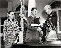 Jackie Cochran and Chuck Yeager being presented with the Harmon International Trophies by President Eisenhower. Courtesay AFFTC History Office